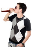 Young man with a bottle Royalty Free Stock Photos