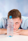 Young man with bottle Royalty Free Stock Photo
