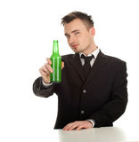 Young man with bottle of beer Royalty Free Stock Images