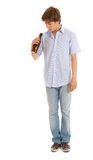 Young man with bottle of beer, full length Royalty Free Stock Photos
