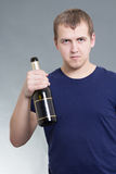 Young man with bottle of champagne Stock Photos