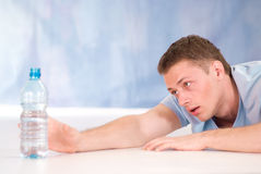 Young man with bottle of water Royalty Free Stock Image