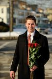 Young man with a bouquet Royalty Free Stock Photos