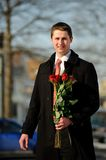 Young man with a bouquet Royalty Free Stock Image