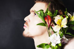 Young man with a bouquet of flowers Stock Photos
