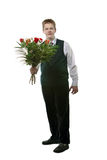 The young man with a bouquet of flowers Royalty Free Stock Photography