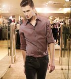 Young man in the boutique Royalty Free Stock Photos