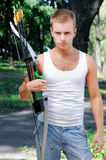 Young man with a bow Stock Image
