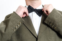 Man fixing bow tie Stock Photography