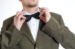 Man fixing bow tie Royalty Free Stock Photography