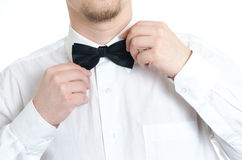 Man fixing bow tie Stock Images