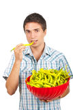 Young man with a bowl full of pepper Royalty Free Stock Photos