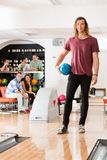 Young Man With Bowling Ball in Club Royalty Free Stock Image