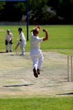Young man bowling cricket ball Royalty Free Stock Photos