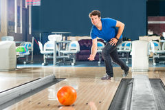 Young man bowling having fun Stock Photos