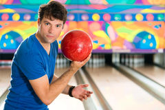 Young man bowling having fun Royalty Free Stock Photography