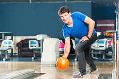 Young man bowling having fun Stock Photography