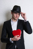 Young man with a box like heart love Stock Photography