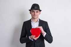 Young man with a box like heart love Stock Image