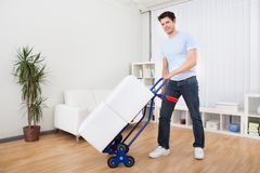Young Man With Box On Trolley Stock Images