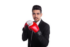 Young man boxer in black suit and red boxing gloves Royalty Free Stock Photos