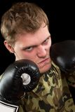Young man in boxing gloves Stock Photo