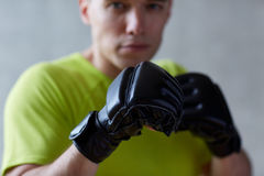 Young man in boxing gloves indoors Royalty Free Stock Image
