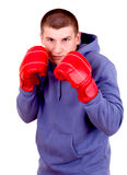 Young man in boxing gloves Royalty Free Stock Photos