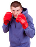 Young man in boxing gloves Royalty Free Stock Photography