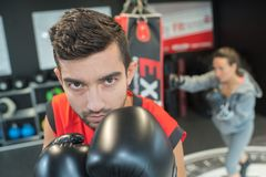 Young man boxing in gym stock image