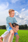 Young man and boy Royalty Free Stock Photo