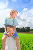 Young man and boy Royalty Free Stock Image