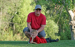 Young man and boy at park Stock Image