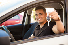 Young man with a brand new car Stock Photography