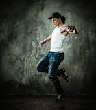Young man break-dancer Royalty Free Stock Photo
