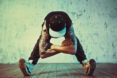 Young man break dancing Stock Images