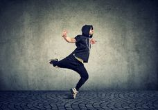 Young man break dancing on wall background Royalty Free Stock Photo