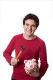 Young man break the piggy bank. Young man break his full piggy bank Royalty Free Stock Photography