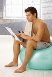 Young man on break of training Royalty Free Stock Images