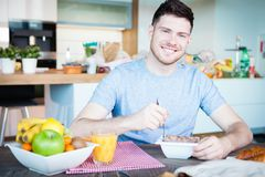 Young man breakfast Royalty Free Stock Photo