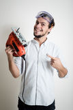 Young man bricolage working with electric saw Royalty Free Stock Image