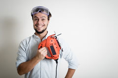 Young man bricolage working with electric saw Stock Photography