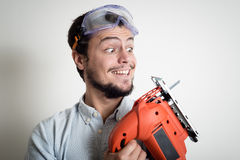 Young man bricolage working with electric saw Royalty Free Stock Photo