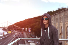 Young man on a bridge in a big city Royalty Free Stock Photography