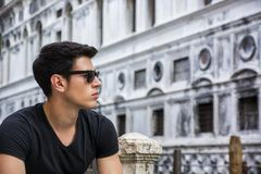 Young Man on Bridge Over Narrow Canal in Venice Royalty Free Stock Photo