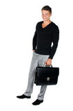 Young man with briefcase standing Royalty Free Stock Photo