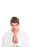 Young man bright-eyed blonde praying. Isolated on white background standing royalty free stock photos