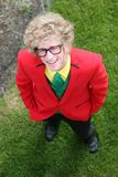 Young man with brightly colored suit Royalty Free Stock Photography