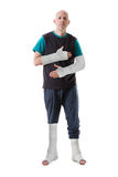 Young man with a broken ankle and a leg cast Royalty Free Stock Images