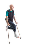 Young man with a broken ankle and a leg cast Royalty Free Stock Photos